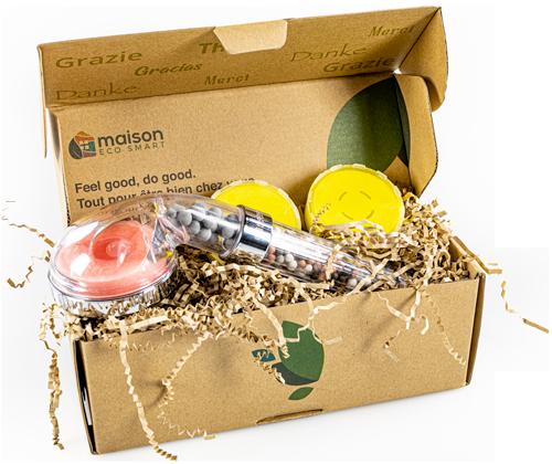 pommeau de douche filtrant dans sa boite en carton avec les arômes citron et rose