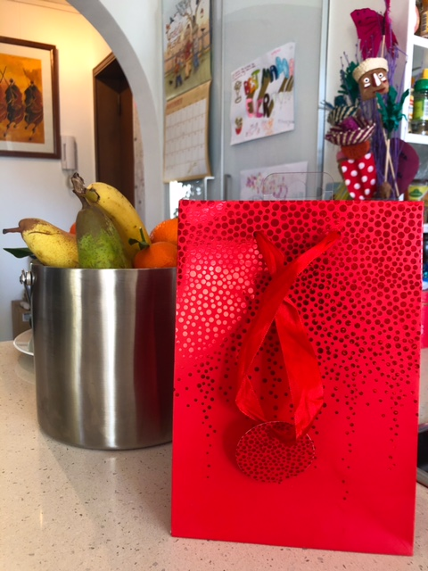 Reuse gift bags to reduce waste in wrapping holiday gifts
